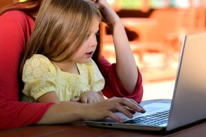 child learning on computer