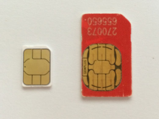 Cutting a SIM card and making a nano SIM card for iPhone and iPad: nano SIM card compared to SIM card